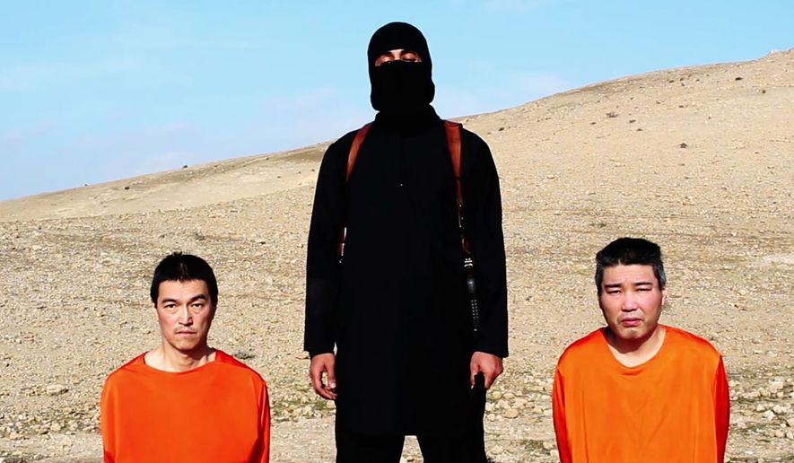 This file image taken from an online video released by the Islamic State group's al-Furqan media arm on Tuesday, Jan. 20, 2015, purports to show the group threatening to kill two Japanese hostages that the militants identify as Kenji Goto Jogo, left, and Haruna Yukawa, right, unless a $200 million ransom is paid within 72 hours. (AP Photo, File)