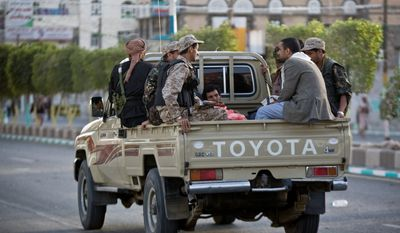Houthi fighters patrolled the streets during a demonstration to show support for their comrades in Sanaa, Yemen, on Friday. Some of the thousands of protesters supported the Shiite rebels who seized the capital, and others demanded that the country's south secede after the nation's president and Cabinet resigned. (Associated Press)