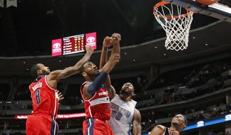 From left, Washington Wizards guards Rasual Butler and John Wall battle for control of a rebound on the final shot with Denver Nuggets forward Darrell Arthur while Wizards guard Paul Pierce looks on as time runs out in the overtime period of an NBA basketball game Sunday, Jan. 25, 2015, in Denver. The Wizards won 117-115 in overtime. (AP Photo/David Zalubowski)