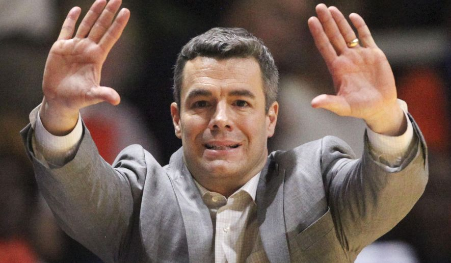 Virginia head coach Tony Bennett signals his team during an NCAA college basketball game against Virginia Tech in Blacksburg, Va., Sunday, Jan. 25, 2015. (AP Photo/The Roanoke Times, Matt Gentry) LOCAL TELEVISION OUT; SALEM TIMES REGISTER OUT; FINCASTLE HERALD OUT;  CHRISTIANBURG NEWS MESSENGER OUT; RADFORD NEWS JOURNAL OUT; ROANOKE STAR SENTINEL OUT