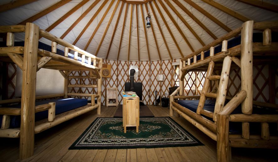 FILE- In this April 2, 2013, file photo, the interior of the yurt at Muskegon State Park is shown, in Muskegon, Mich. The Michigan Department of Natural Resources has announced the first across-the-board increase in camping rental rates in seven years for 2015. The yurt, which used to cost $60 a night, now will cost $65. (AP Photo/The Muskegon Chronicle-MLive Media Group, Ariana van den Akker, File)