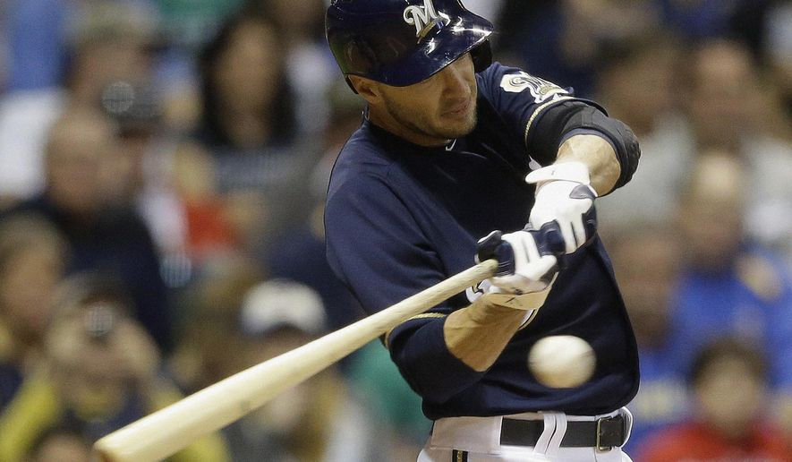 FILE - In this May 8, 2013, file photo, Milwaukee Brewers' Ryan Braun hits a triple during the sixth inning of a baseball game against the Texas Rangers in Milwaukee. Braun says his thumb feels great while swinging following an offseason procedure to address nerve damage in his right hand. (AP Photo/Morry Gash, File)