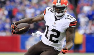 Cleveland Browns wide receiver Josh Gordon carries the ball after a reception against the Buffalo Bills during the first half of an NFL football game in Orchard Park, N.Y., in this Nov. 30, 2014, file photo. The Browns say they are disappointed about a report that troubled wide receiver Gordon has failed another drug test and could be facing a one-year NFL ban. (AP Photo/Bill Wippert, File)