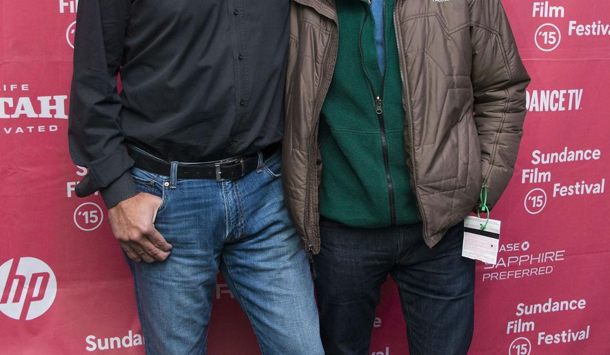 """From left, Director Louie Psihoyos and Fisher Stevens attend the premiere of """"Racing Extinction"""" during the 2015 Sundance Film Festival on Saturday, Jan. 24, 2015, in Park City, Utah. (Photo by Arthur Mola/Invision/AP)"""