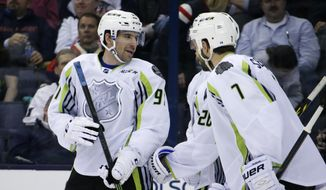 Team Toews' John Tavares, left, of the New York Islanders celebrates his goal with teammates during the second period of the NHL All-Star hockey game in Columbus, Ohio, Sunday, Jan. 25, 2015. (AP Photo/Gene J. Puskar)