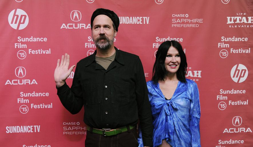 """Krist Novoselic, left, former bass player of Nirvana, and his wife Darbury Stenderu arrive at the premiere of the documentary film """"Kurt Cobain: Montage of Heck,"""" at The MARC Theatre during the 2015 Sundance Film Festival on Saturday, Jan. 24, 2015, in Park City, Utah. (Photo by Chris Pizzello/Invision/AP)"""
