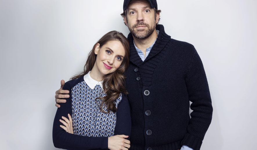 """Alison Brie, left, and Jason Sudeikis pose for a portrait to promote the film, """"Sleeping with Other People"""", at the Eddie Bauer Adventure House during the Sundance Film Festival on Saturday, Jan. 24, 2015, in Park City, Utah. (Photo by Victoria Will/Invision/AP)"""