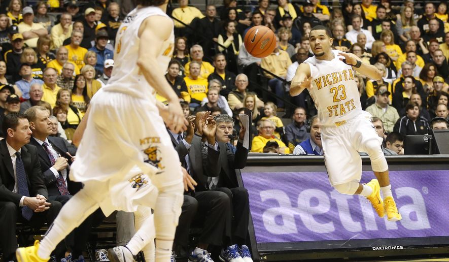 Wichita State's Fred VanVleet saves a ball from going out of bounds in the first half of an NCAA college basketball game against Drake, Sunday, Jan. 25, 2015, in Wichita, Kan. (AP Photo/The Wichita Eagle, Jaime Green) LOCAL TV OUT; MAGAZINES OUT; LOCAL RADIO OUT; LOCAL INTERNET OUT