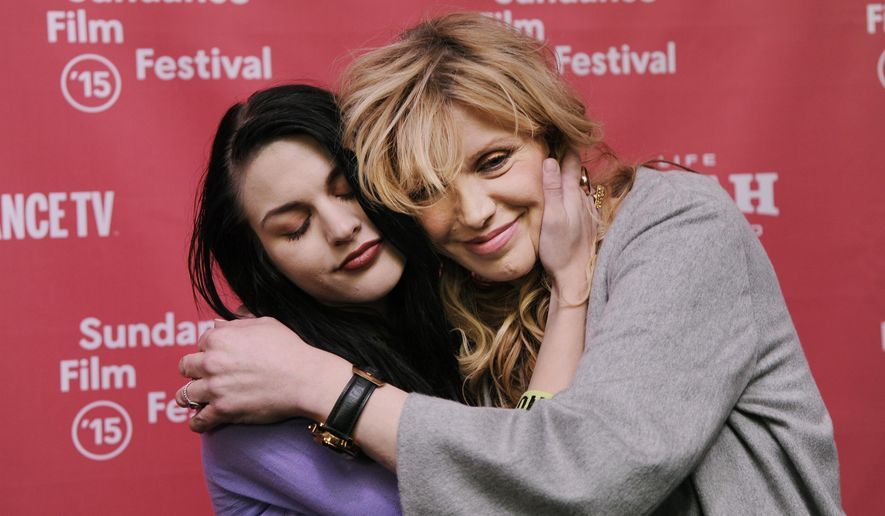 "Frances Bean Cobain, left, daughter of Kurt Cobain and executive producer of the documentary film ""Kurt Cobain: Montage of Heck,"" embraces her mother and Cobain's widow Courtney Love at the premiere of the film at The MARC Theatre during the 2015 Sundance Film Festival on Saturday, Jan. 24, 2015, in Park City, Utah. (Photo by Chris Pizzello/Invision/AP)"