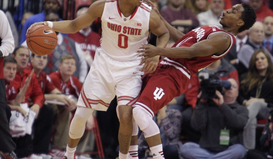 Ohio State's D'Angelo Russell, left, posts up against Indiana's Yogi Ferrell during the first half of an NCAA college basketball game Sunday, Jan. 25, 2015, in Columbus, Ohio. (AP Photo/Jay LaPrete)
