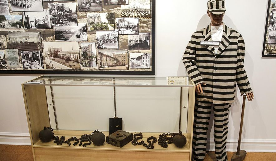 In this Jan. 2, 2015 photo, a temporary exhibit at the Joliet Area Historical Museum in Joliet, Ill., details the history of area prisons. The exhibit uses photographs and artifacts from former prisoners, guards and wardens to show the history of the Joliet Correctional Center on Collins Street, the adjacent Women's Prison and Stateville. (AP Photo/The Herald-News, Lathan Goumas)  MANDATORY CREDIT, CHICAGO TRIBUNE OUT