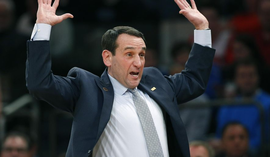 Duke head coach Mike Krzyzewski reacts in the first half of an NCAA college basketball game against St. John's at Madison Square Garden in New York, Sunday, Jan. 25, 2015.  (AP Photo/Kathy Willens)