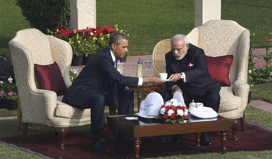 President Obama and Indian Prime Minister Narendra Modi sit for tea after a stroll in the gardens of Hyderabad House, where the leaders held their talks, in New Delhi, India, Sunday. (AP Photo/Press Trust of India) INDIA OUT