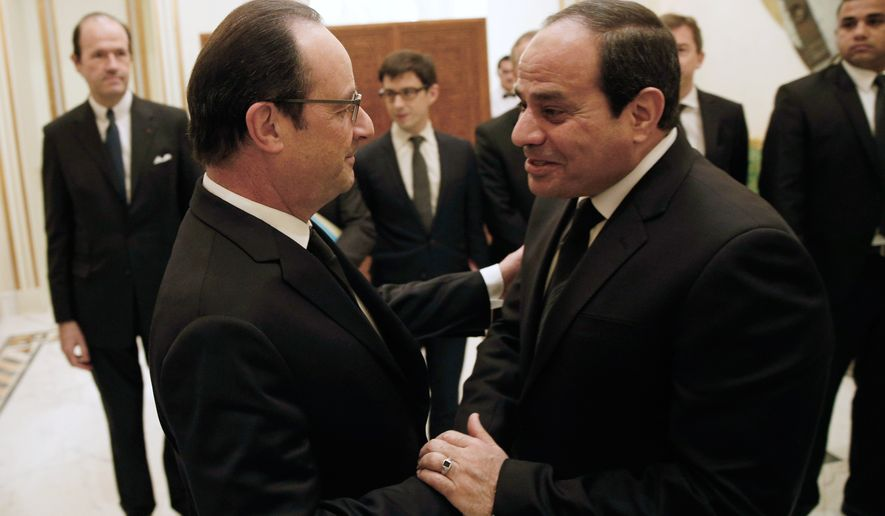 French President Francois Hollande, left, shakes hands with Egyptian President Abdel Fattah al-Sisi during a meeting  in Riyadh, Saturday, Jan. 24, 2015.  (AP Photo/Yoan Valat, Pool)