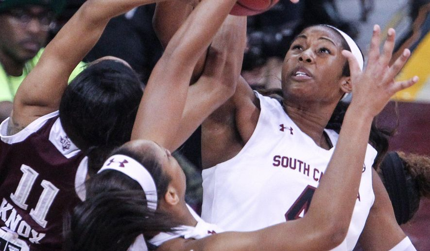 South Carolina's center Alaina Coates (41) pulls down a rebound with teammate A'ja Wilson (22) during the first half of an NCAA college basketball game in Columbia, S.C., Monday, Jan. 26, 2015. South Carolina won 79-61. (AP Photo/The State, Tracy Glantz) ALL LOCAL MEDIA OUT