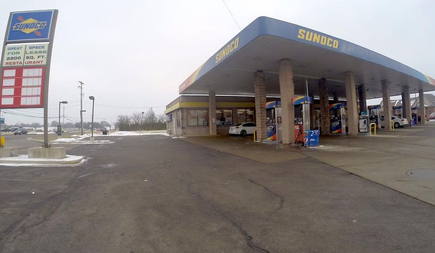 A gas station in Monroe Township, Michigan, that was the scene of an armed robbery is shown on Saturday, Jan. 24, 2015. Police said they arrested two suspects after one of them left his wallet behind during the robbery. (AP Photo/The Monroe Evening News, Rob Gorczyca)