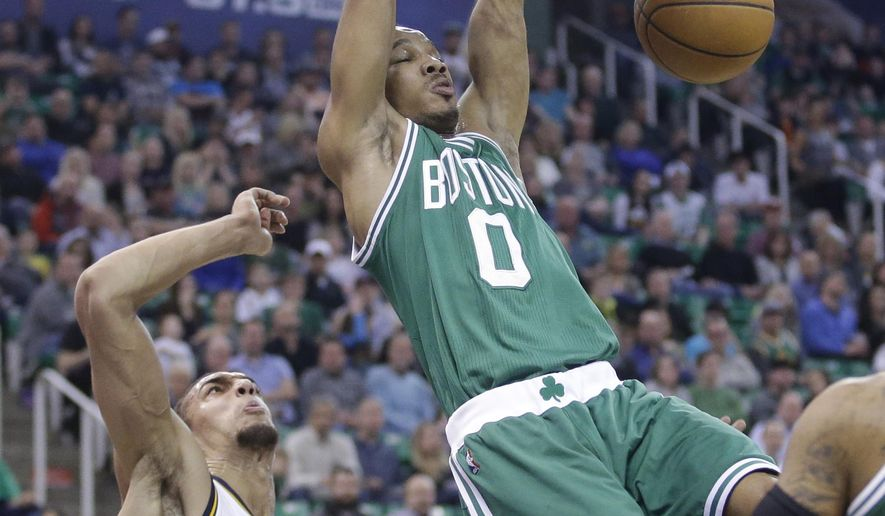 Boston Celtics guard Avery Bradley (0 )dunks the ball as Utah Jazz center Rudy Gobert (27) defends in the second quarter during an NBA basketball game Monday, Jan. 26, 2015, in Salt Lake City.  (AP Photo/Rick Bowmer)
