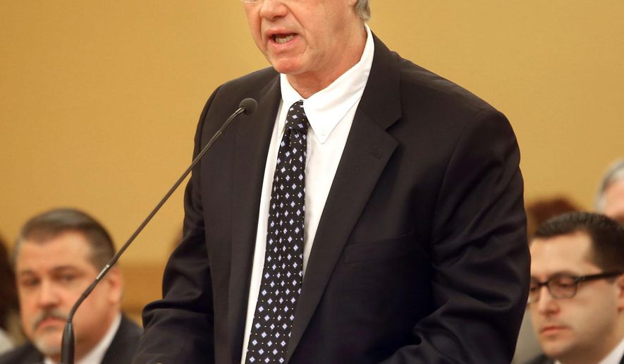 Rex Buchanan, the leader of the Kansas Geological Survey, said Monday, Jan. 26, 2015 during the House Energy and Environment Committee meeting, that the agency is moving in the direction of concluding recent earthquakes in the state are being caused by oil and gas production practices. (AP Photo/Topeka Capital-Journal, Thad Allton)