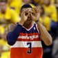 Wizards guard Bradley Beal celebrates a three-point basket. Only four teams in the NBA make fewer threes per game. (Associated Press)