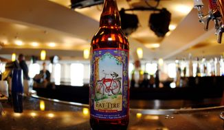 New Belgium and its famous Fat Tire is helping drive a tourist craze of microbreweries in Fort Collins, Colorado. (Associated Press)