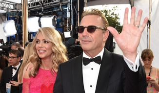 Christine Baumgartner, left, and Kevin Costner arrive at the 21st annual Screen Actors Guild Awards at the Shrine Auditorium on Sunday, Jan. 25, 2015, in Los Angeles. (Photo by John Shearer/Invision/AP)