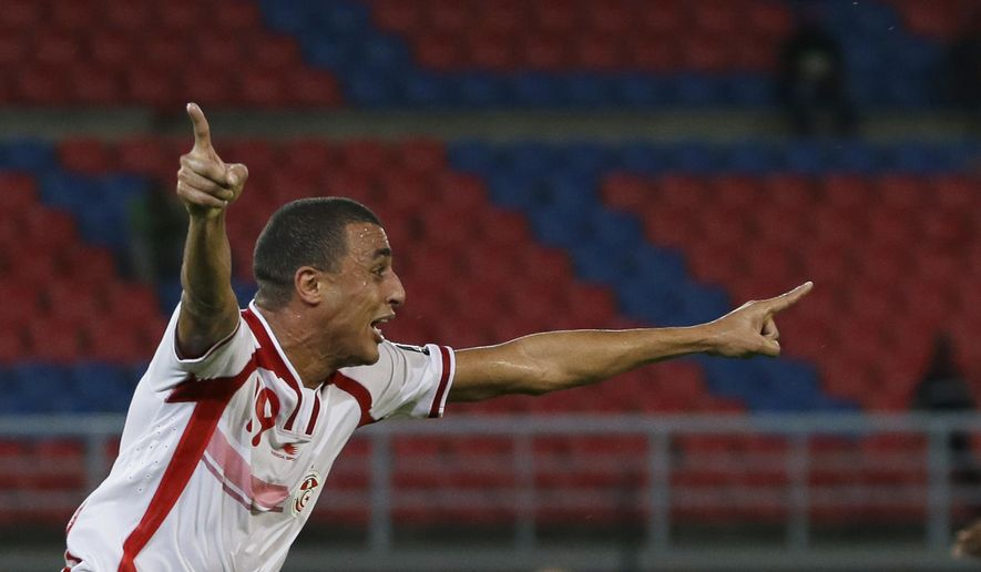 Tunisia's Ahmed Akaichi celebrates scoring a goal during their African Cup of Nations Group B soccer match against DR Congo in Bata, Equatorial Guinea, Monday, Jan. 26, 2015. (AP Photo/Themba Hadebe)