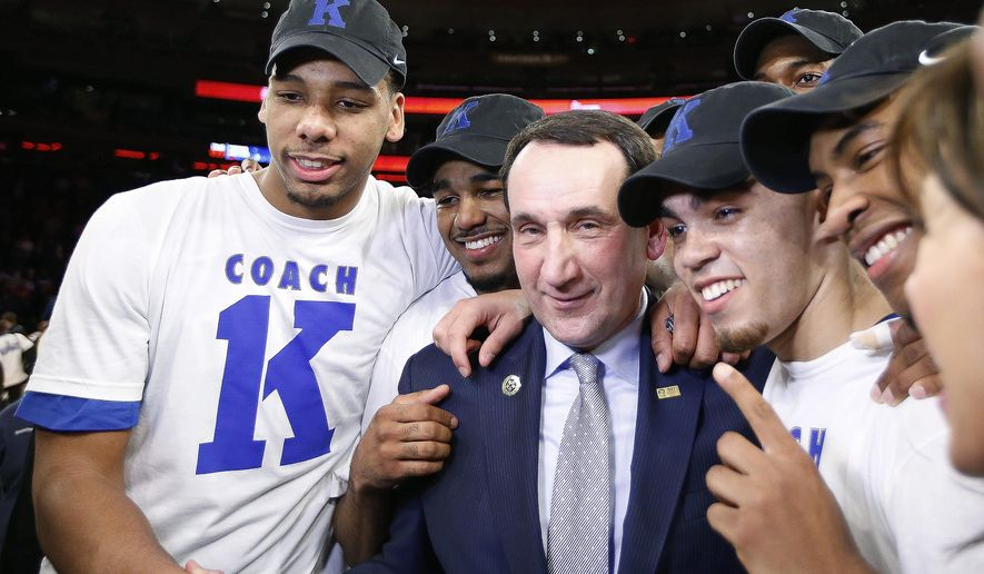 Duke head coach Mike Krzyzewski, center, celebrates with his players after his 1,000th career win in an NCAA college basketball game against St. John's at Madison Square Garden in New York, Sunday, Jan. 25, 2015. Krzyzewski became the first men's coach in Division I history with 1,000 wins. (AP Photo/Kathy Willens)