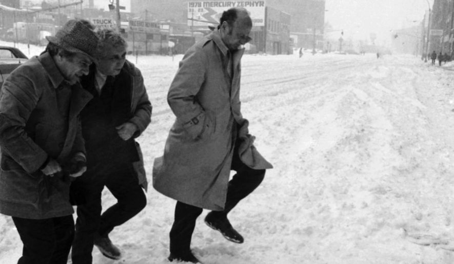 FILE - In this Jan. 20, 1978 file photo, New York City Mayor Ed Koch, right, accompanied by unidentified aides, steps through snow in queens during a tour of New York, to see first hand the conditions brought about by the city's worst storm of the decade. (AP Photo, File)