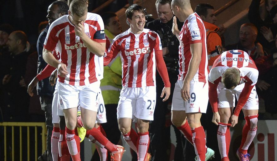 Stoke City's Spanish player Bojan Krkic, centre, celebrates scoring his side's first goal with teammates during their English FA Cup Fourth Round soccer match at Spotland Stadium, in Rochdale, England, Monday Jan. 26, 2015. (AP Photo / Martin Rickett, PA) UNITED KINGDOM OUT - NO SALES - NO ARCHIVES
