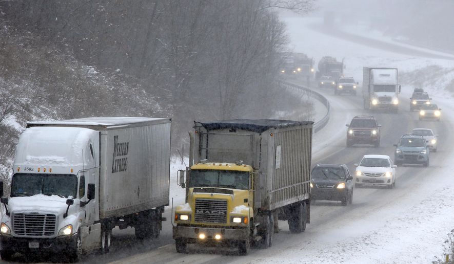 Traffic moves through the falling snow down southbound I79 near Evans City, Pa. on Monday, Jan. 26, 2015. Cities across the Northeast mobilized snowplows and airlines canceled thousands of flights Monday as a potentially historic storm pushed its way up the Philadelphia-to-Boston corridor with what forecasters said could be up to 2 feet of snow. (AP Photo/Keith Srakocic)