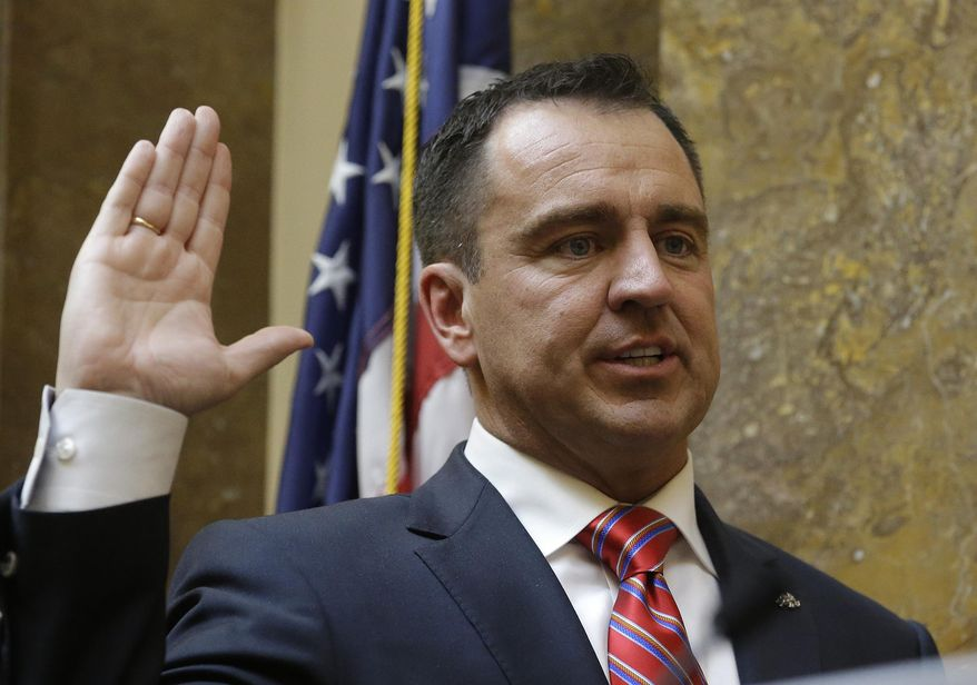 Greg Hughes is sworn in as Speaker of the House at the Utah State Capitol Monday, Jan. 26, 2015, in Salt Lake City. Utah lawmakers kick off their legislative session on Monday as they prepared to devote the first week to preliminary budget meetings. Among the items they'll need to consider is a plan to relocate a state prison in Draper, whether or not they'll expand eligibility for Medicaid and a package of reforms to Utah's criminal justice system. (AP Photo/Rick Bowmer)