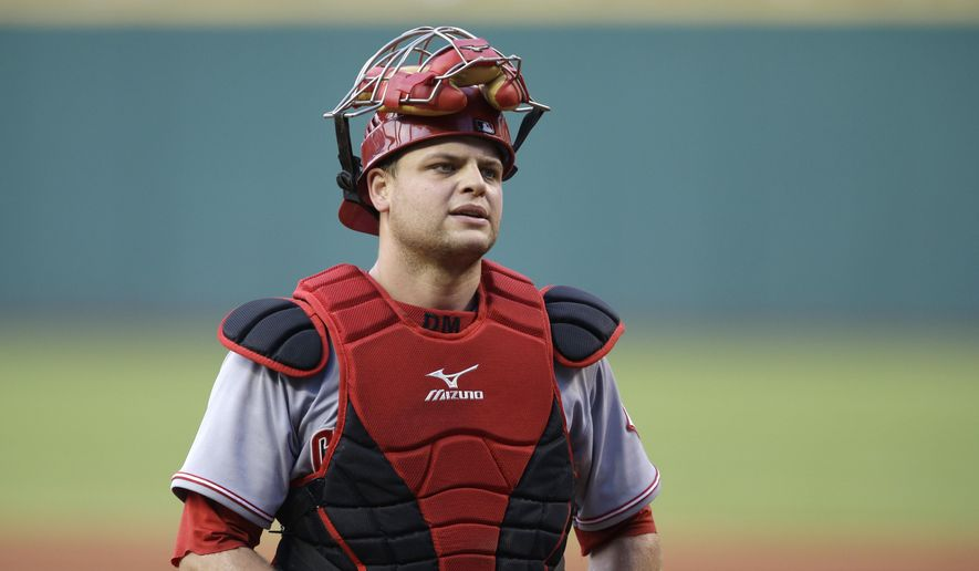 FILE- This Aug. 4, 2014, file photo shows Cincinnati Reds catcher Devin Mesoraco during a baseball game Cleveland Indians in Cleveland. All-Star catcher Mesoraco agreed to a $28 million, four-year contract on Monday, Jan. 26, 2015. (AP Photo/Mark Duncan, File)