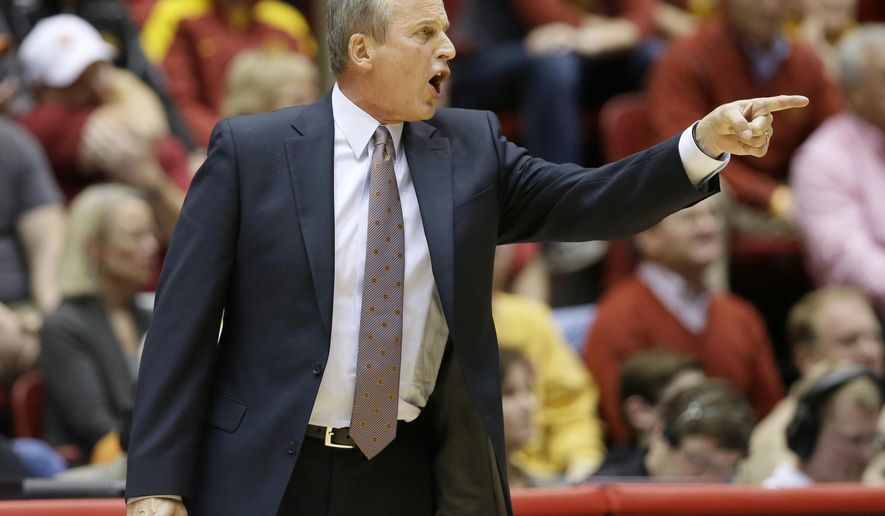 Texas head coach Rick Barnes directs his team during the first half of an NCAA college basketball game against Iowa State, Monday, Jan. 26, 2015, in Ames, Iowa. (AP Photo/Charlie Neibergall)