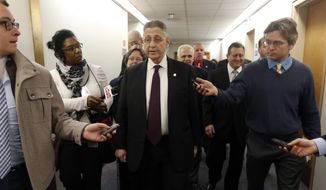 Assembly Speaker Sheldon Silver, D-Manhattan, talks to the media after leaving his office in the Legislative Office Building on Monday, Jan. 26, 2015, in Albany, N.Y. Silver was fighting to keep his grip on power Monday amid widening calls for his resignation in the wake of federal corruption charges. (AP Photo/Mike Groll)