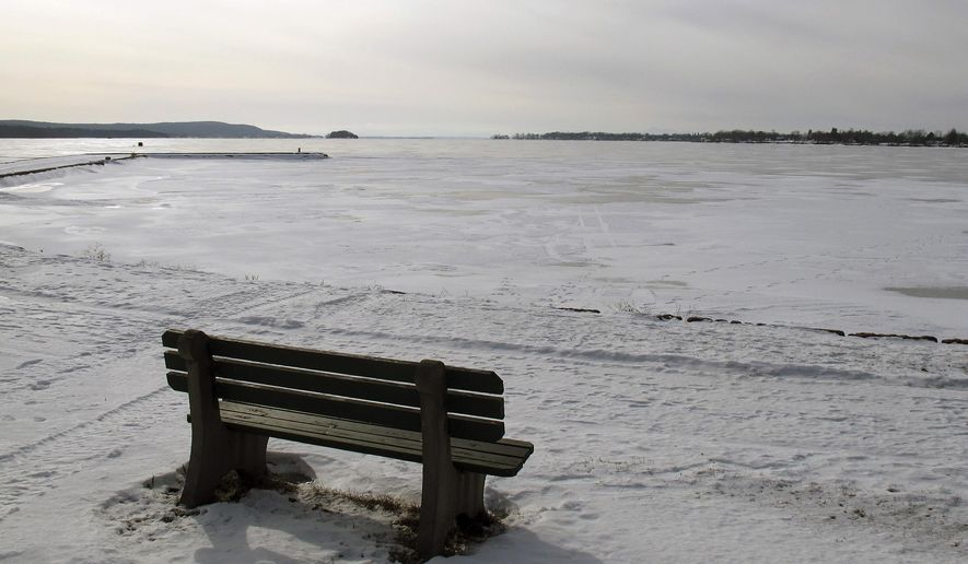 An empty bench is along the shore of frozen St. Albans Bay, an arm of Lake Champlain, Monday, Jan 26, 2015 in St. Albans, Vt. State officials said during a meeting Monday in St. Albans that legal enforcement of water quality rules on the state's farmers is going to be one of the tools used to help clean up Lake Champlain. The enforcement could include civil fines, a loss of tax breaks for agricultural lands and the ability to limit livestock. (AP Photo/Wilson Ring)
