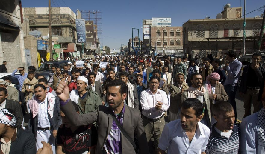 Protesters chant slogans against Houthi Shiite rebels who hold the capital, Sanna, amid a power vacuum as they march on a street in Sanaa on Saturday, Jan. 24, 2015. Some 20,000 marched Saturday across the capital, where demonstrators converged on the house of President Abed Rabbo Mansour Hadi, who resigned Thursday along with his Cabinet. (AP Photo/Hani Mohammed)