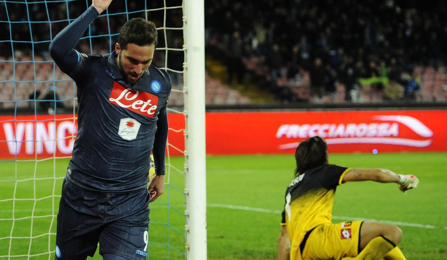 Napoli's Gonzalo Higuain celebrates after scoring during a Serie A soccer match between Napoli and Genoa, at the San Paolo stadium in Naples, Italy, Monday, Jan. 26, 2015. (AP Photo/Salvatore Laporta)