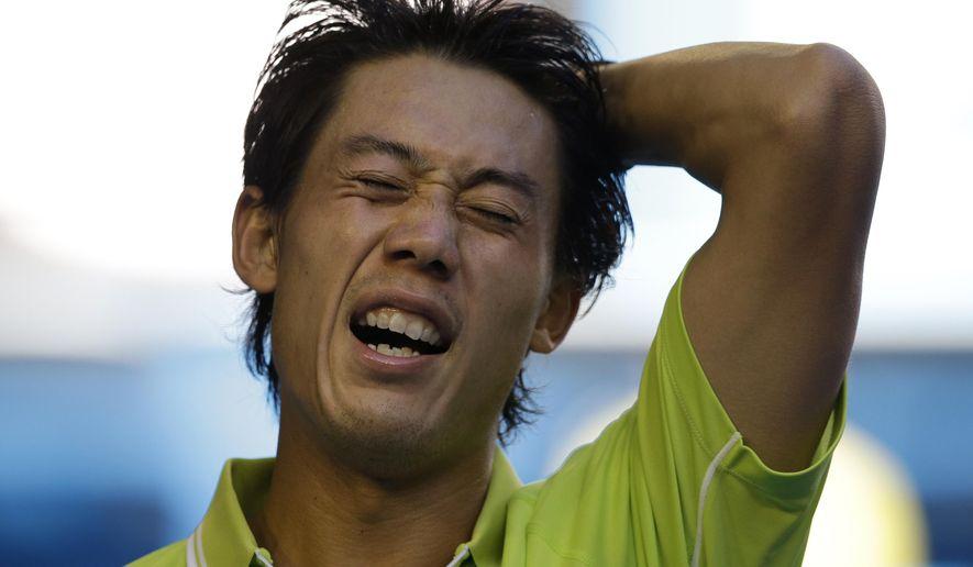 Kei Nishikori of Japan celebrates after winning over David Ferrer of Spain in their fourth round match at the Australian Open tennis championship in Melbourne, Australia, Monday, Jan. 26, 2015. (AP Photo/Lee Jin-man)