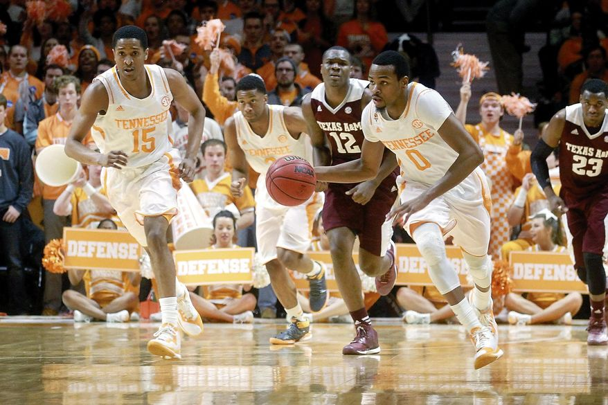 Tennessee's Kevin Punter (0) takes the ball down court during an NCAA college basketball against Texas A&M, Saturday, Jan. 24, 2015, at Thompson-Boling Arena in Knoxville, Tenn.  (AP Photo/The Daily Times, Mark A. Large) MANDATORY CREDIT