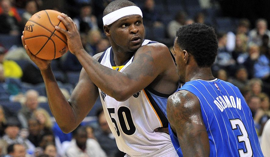 Memphis Grizzlies forward Zach Randolph (50) controls the ball against Orlando Magic center Dewayne Dedmon (3) in the second half of an NBA basketball game Monday, Jan. 26, 2015, in Memphis, Tenn. (AP Photo/Brandon Dill)