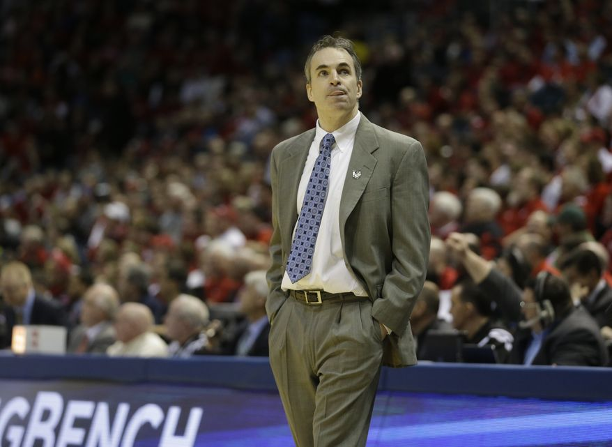 American head coach Mike Brennan directs his team during the first half of a second-round game against the Wisconsin in the NCAA college basketball tournament Thursday, March 20, 2014, in Milwaukee. (AP Photo/Morry Gash)