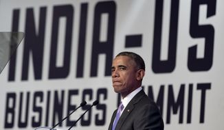 U.S President Barack Obama pauses as he speaks at the CEO Summit at theTaj Palace Hotel in New Delhi, India, Monday, Jan. 26, 2015. Officials in both countries say Obama and Modi developed an easy chemistry when they first met in Washington last fall. The two leaders spent several hours together Sunday and heralded their close relationship. (AP Photo/Carolyn Kaster)