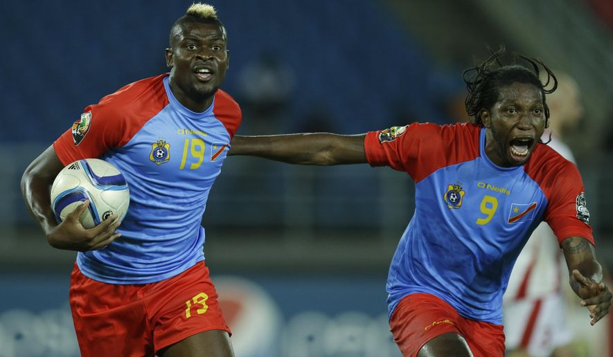 DR Congo's Loteteka Jeremy Bokila, left, celebrates with teammate Diedonnei Mbokani after scoring a goal during their African Cup of Nations Group B soccer match against Tunisia in Bata, Equatorial Guinea, Monday, Jan. 26, 2015. (AP Photo/Themba Hadebe)