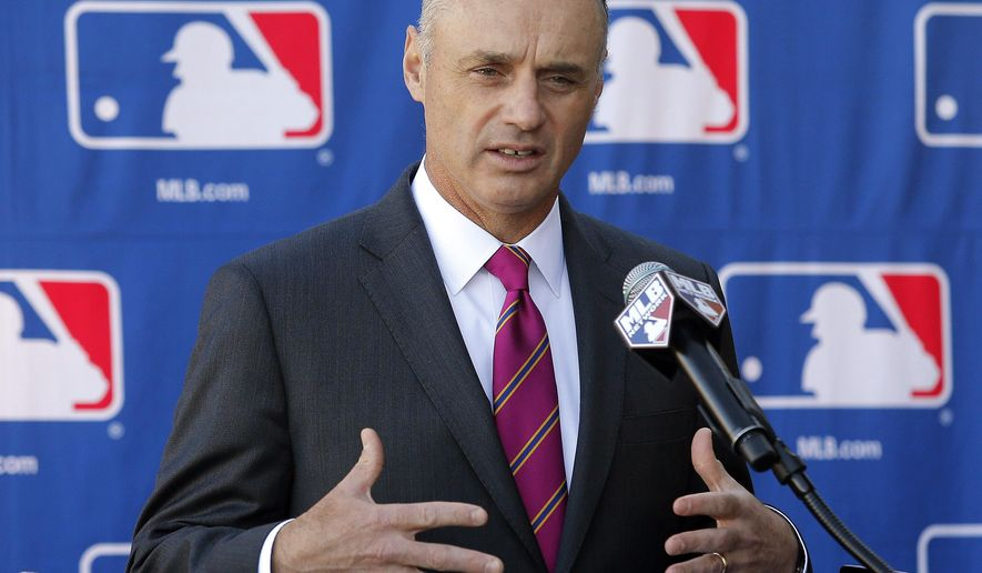 FILE - In a Jan. 15, 2015 file photo then Commissioner-elect Rob Manfred speaks during a news conference at the Major League Baseball owners meeting in Phoenix.   Monday morning, Jan. 26, 2015, was the first business day after Manfred succeeded Bud Selig and started a five-year term as commissioner. (AP Photo/Rick Scuteri, file)