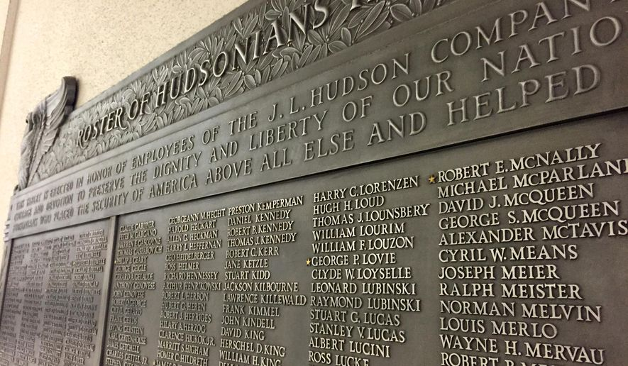 A Jan. 22, 2015 photo shows a large wall-mounted plaque with 1,146 names that commemorates employees of the J.L. Hudson Co. who served in World War II. The plaque was originally place in the Hudson's flagship department store in downtown Detroit, but was moved to Northland Center Mall in Southfield after the store closed in 1983. The plaque is now outside the Macy's store within Northland Center mall. The plaque will be relocated to another Detroit area Macy's once the Northland Macy's closes this spring. (AP Photo/Detroit Free Press, JC Reindl)  DETROIT NEWS OUT;  NO SALES