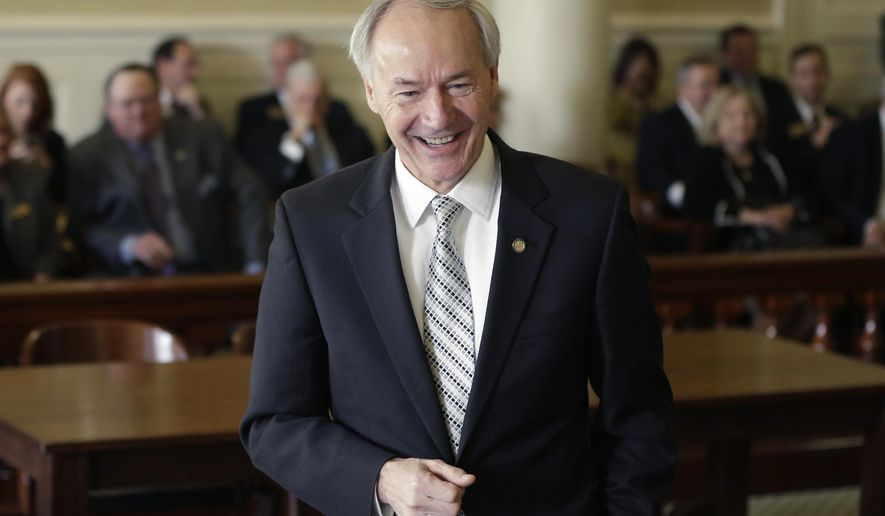 In this photo taken Jan. 21, 2015, Arkansas Gov. Asa Hutchinson visits the Senate Committee on Revenue and Taxation at the Arkansas state Capitol in Little Rock, Ark. A House leader Monday, Jan. 26, 2015, said lawmakers are looking at changing the governor's tax cut package to restore part of a $21 million capital gains tax reduction that would otherwise be repealed. (AP Photo/Danny Johnston)