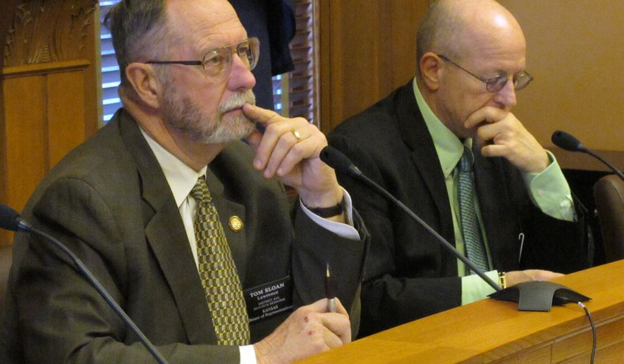 Chairman Tom Sloan, left, a Lawrence Republican, listens to testimony during a Kansas House Vision 2020 Committee hearing on expanding the state's Medicaid program to capture extra federal dollars promised by the federal health care law, Monday, Jan. 26, 2015, at the Statehouse in Topeka, Kan. To his right is Rep.  Larry Campbell, an Olathe Republican. (AP Photo/John Hanna)