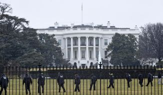 Secret Service officers search the south grounds of the White House in Washington, Monday, Jan. 26, 2015. A device, possibly an unmanned aerial drone, was found on the White House grounds during the middle of the night while President Obama and the first lady were in India, but his spokesman said Monday that it posed no threat. (AP Photo/Susan Walsh) **FILE**