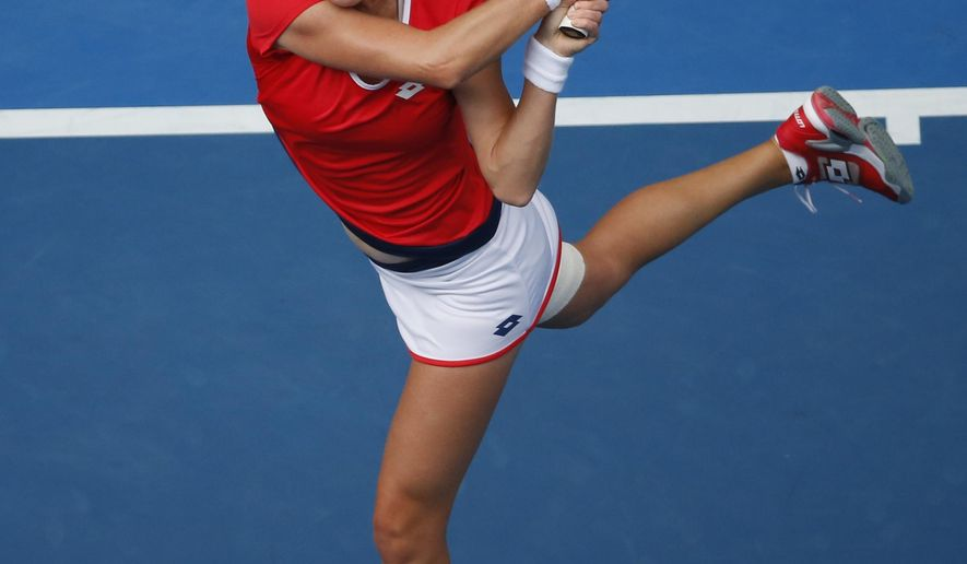 Ekaterina Makarova of Russia plays a shot to Simona Halep of Romania during their quarterfinal match at the Australian Open tennis championship in Melbourne, Australia, Tuesday, Jan. 27, 2015. (AP Photo/Vincent Thian)