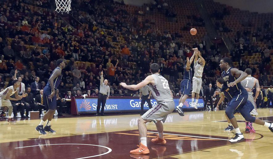 Virginia Tech's Adam Smith (3) shoots the winning basket in overtime against Pittsburgh in an NCAA college basketball game Tuesday,  Jan. 27, 2015, in Blacksburg, Va. Virginia Tech won 70-67. (AP Photo/The Roanoke Times, Don Petersen)